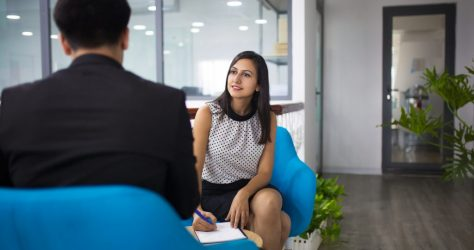 Portrait of smiling hr manager having interview with candidate